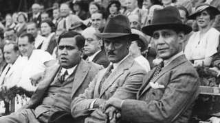 circa 1950: Sir Hamidullah Khan (1894 - 1960), the Nawab of Bhopal (right), sitting with Mr Haider and Colonel Hughdensville, watching an exhibition tennis match given in his honour. (Photo by Hulton Archive/Getty Images)