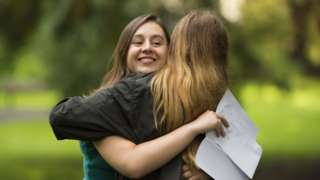 Holly Cuttiford hugs her mum after receiving her A Level results at Ffynone House School on August 13, 2020 in Swansea