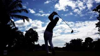 Silhouetted golf player in Thailand