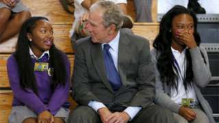 Former US President George W. Bush talks with schoolchildren at Warren Easton Charter High School one day before the ten year anniversary of Hurricane Katrina in New Orleans, Louisiana, 28 August 2015.