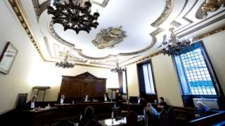 Image shows the Vatican courtroom