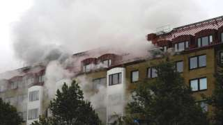 Smoke comes out of windows after an explosion hit an apartment building in Annedal, central Gothenburg, Sweden September 28, 2021