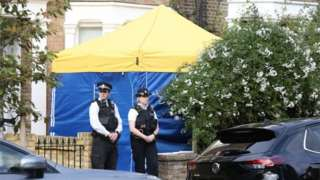 Police officers outside a house in north London