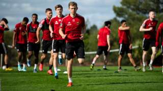 The Ostersund players complete another running session.