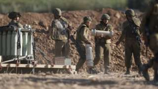Israel has amassed artillery at the border with Gaza raising fears of a ground offensive