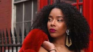 Model holding coat over her shoulder