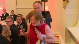 Mark Field walking the female protester out