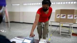 A woman votes in Caracas. 6 Dec 2020