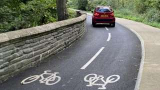 Car on the cycle path