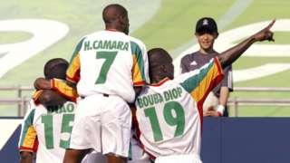 Salif Diao (left), Henri Camara (centre) and Papa Bouba Diop celebrate a goal at the 2002 World Cup