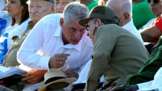 Cuban President Raul Castro (R) talking to First Vice President Miguel Diaz Canel (L),