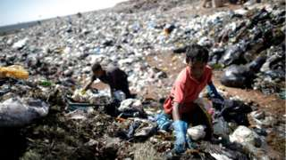 "A child works at ""Lixao da Estrutural"", Latin America""s largest rubbish dump, in Brasilia, Brazil, January 19, 2018"