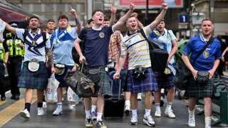 Scotland fans leaving Glasgow