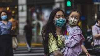 Људи на улици, Кина, мај 2021.