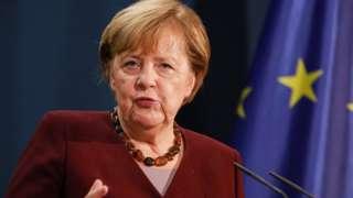 Angela Merkel at a lectern