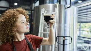 Woman working in craft brewery