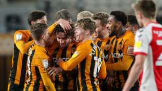 Hull City players mob match-winner Lewie Coyle