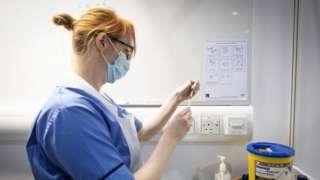 Nurse prepares coronavirus vaccine