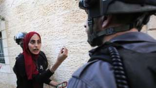 Palestinian woman argues with Israeli policeman