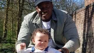 Nathan Burton with his daughter