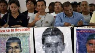 Relatives of some of the 43 missing students of Ayotzinapa, offer a press conference after meeting with Mexican President Andres Manuel Lopez Obrador, in Mexico City, on September 11, 2019