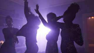 Girls dancing at a house party