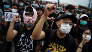 """Protesters attend a demonstration demanding Hong Kong""""s leaders to step down and withdraw the extradition bill, in Hong Kong, China, June 17, 2019."""
