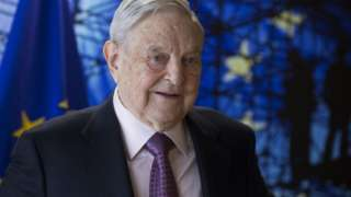 George Soros, pictured in front of EU flag in April 2017