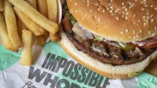 A close-up of the Impossible Whopper and fries