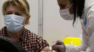 A woman gets a Covid-10 vaccine in Belgrade, Serbia. File photo
