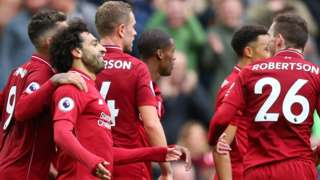 Liverpool players celebrate scoring against Southampton