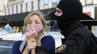 Woman protester being arrested in Minsk, 19 Sep 20
