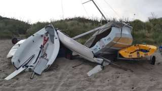 Boats battered on the beach