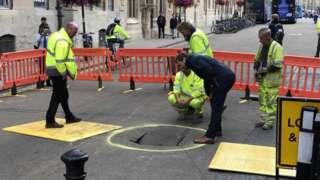 Workmen inspecting the sinkhole on Broad Street