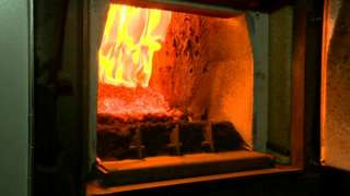 Wood pellets burning in a biomass boiler