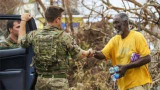 British Army troops shaking hands with a resident in Tortola, British Virgin Islands
