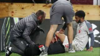 Liverpool defender Joe Gomez receives medical attention after sustaining a fracture leg during a Premier League match against Burnley