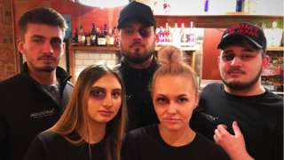 Bar staff with make-up black eyes