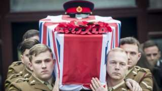 The coffin for Lance Corporal Scott Hetherington is carried from All Saints and Martyrs Church in Middleton, Greater Manchester following a Military funeral.
