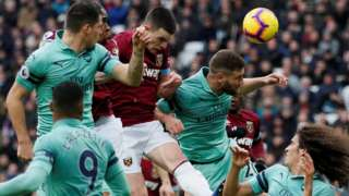 Declan Rice wins a header