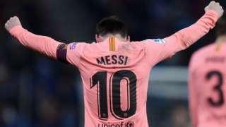 Lionel Messi celebrates scoring for Barcelona against Espanyol in La Liga