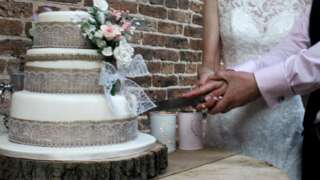 Couple cut a wedding cake