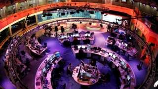 The newsroom at the headquarters of the Qatar-based Al Jazeera English-language channel in Doha, 7 February