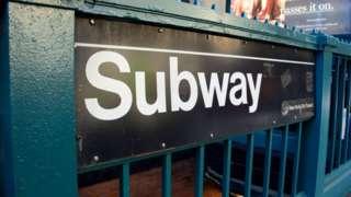 A New York subway entrance sign