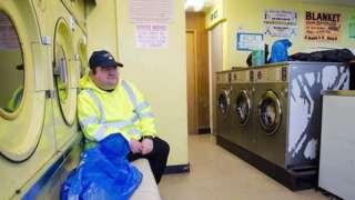 Man in launderette