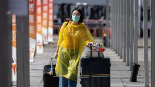 An air passenger wearing protective equipment in Hong Kong, China