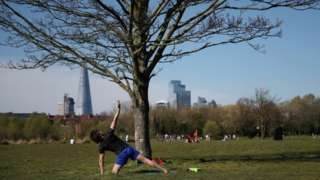 A man exercises in Burgess Park in south London on Sunday