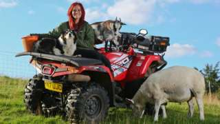 Hannah Jackson with some of her animals on her quad bike