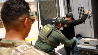 US border patrol officials detain a migrant in the US state of New Mexico. File photo