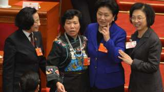 Four female delegates pose for a photograph at China's National People's Congress in the Great Hall of the People in Beijing on March 16, 2013.